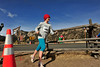 "Walt Hester | Trail Gazette<br /> Fort Collins runner Loni Thorson crosses Devils Gulch Road to across anoth pasture during Sunday's 10k race. ""This was my first race, ever. I just wanted to runat elevation,"" said Thorson."