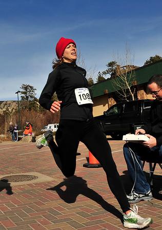Walt Hester | Trail Gazette<br /> Estes Park's Ruby Bode crosses the line of the Frost Giant 10k run on Sunday. Bode won the women's division in 43:34.