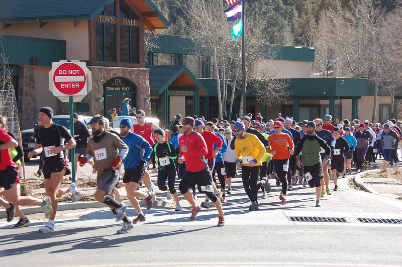 Runners leave the starting area for the 5K portions of the 33rd running of the Frost Giant in Estes Park. The race started Sunday, Jan. 29 under blue skies with a brisk wind.
