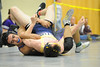 Walt Hester | Trail Gazette<br /> Estes Park's Bailey Flores tangles with a Colorado Springs Christian opponent during the Thin Air Tournament on Saturday. Flores placed third in the 126-pound weight class.