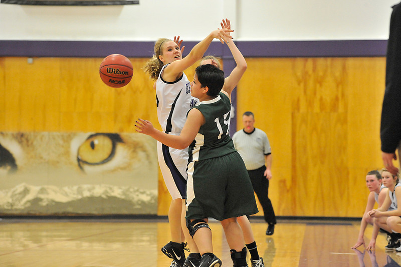 Walt Hester   Trail Gazette<br /> Estes Park's Logan Morris helps frustrate the Highland Huskies on Friday. The Ladycats forced 22 turnovers in their game against the Huskies.