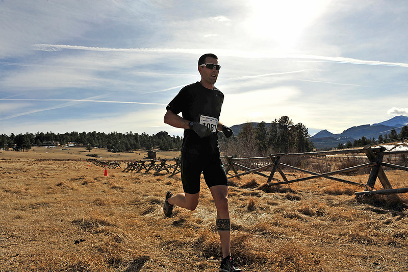 Walt Hester | Trail Gazette<br /> Rob Kosick of Denver opens a gap between himself and the rest of the Frost Giant pack during Sunday's 10k. Kosick not only won the 10k, 37:19.10, but also the earlier 5k race in a time of 18:16.5.