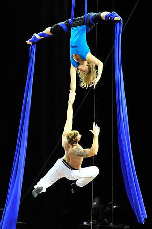 Walt Hester | Trail Gazette<br /> Amanda Orozco dangles from silk lines while holding fellow performer Lorant Markocsany during Tuesday rehearsal for the Loveland performance of Cirque du Soleil's Dralion. The show runs at the Budweiser Event Center tonight through Sunday, then moves to the Broomfield's 1stBank Event Center February 8-12.