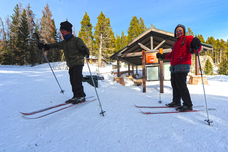 Walt Hester | Trail Gazette<br /> Stuart Snider and Mary Ann Brooks, both of Tucson, Ariz., head toward the trail at BearLake on Wednesday. Many visitors took to the trails ahead of expected snow on Thursday night and Friday.