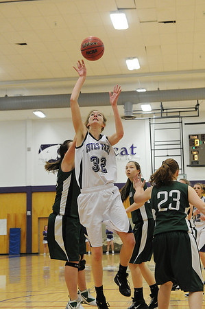 Walt Hester | Trail Gazette<br /> Evelyn Bangs fights for points in the firt quarter against the Highland Huskies on Friday. Bangs led the Ladycats in scoring with 13.