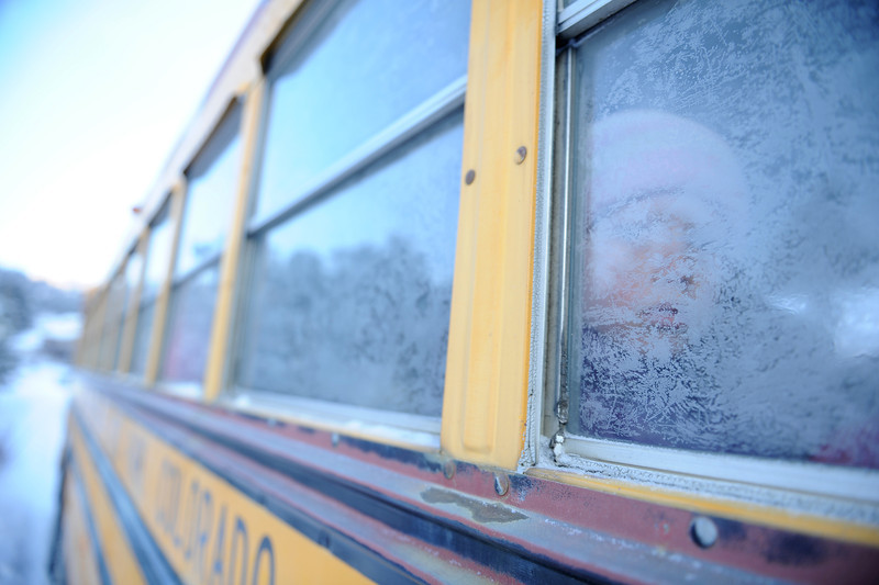 Walt Hester | Trail Gazette<br /> CHildren get a frosty view from bus windows on Tuesday morning. New snow and sub-zero cold greeted Estes Park residents as th day began.