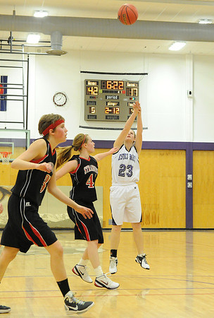 Walt Hester | Trail Gazette<br /> Jesse O'Dell shoots for two of her team-leading 13 points in the final quarter of the Estes Park girls' lopsided victory over the visiting Strasburg Indians on Monday night. Three Ladycats finished in double figures in points.