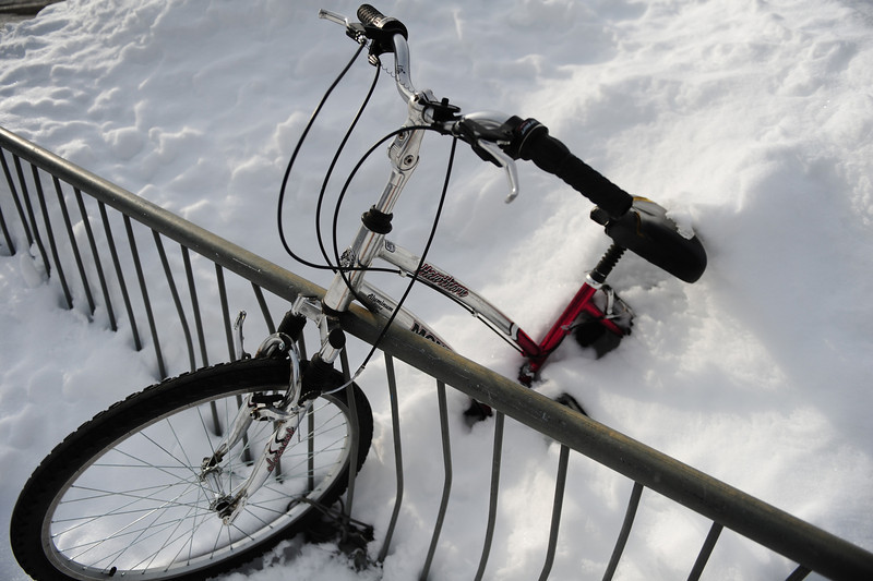 Walt Hester | Trail Gazette<br /> An abandon bike sits buried at the Estes Park High School on Monday. Plows had plenty to push off the lots after a foot of snow fell on the area.
