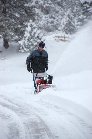 A homeowner in the Carriage Hills subdivision uses a snowblower to clear his driveway Friday morning, Feb. 3 after a storm dumped close to 10 inches of snow on parts of the Estes Valley. More snow was expected to fall throughout the day.