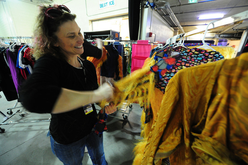Walt Hester | Trail Gazette<br /> Rebecca Spafford of Fort Collins brushes out a costume on January 31. It's not as glamorous as performing, but the folks behind the stage who repair and prepair the props and costumes are every bit as crucial to the show.