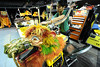 Walt Hester | Trail Gazette<br /> Kevin Chung works on a dragon head back stage on January 31. The group transports piles of props and costumes and an army of craftsman and technicians is reqired to keep everything looking good and running smoothly.