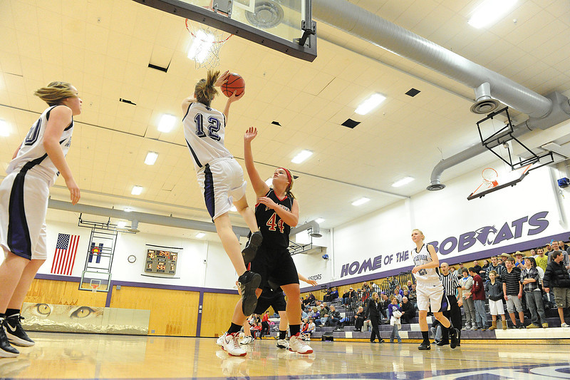 Walt Hester | Trail Gazette<br /> Amanda Dill works around under the Ladycats basket for two on Tuesday night against Strasburg. Dill contributed 12 points to the girls' lopsided victory over the visiting Indians.
