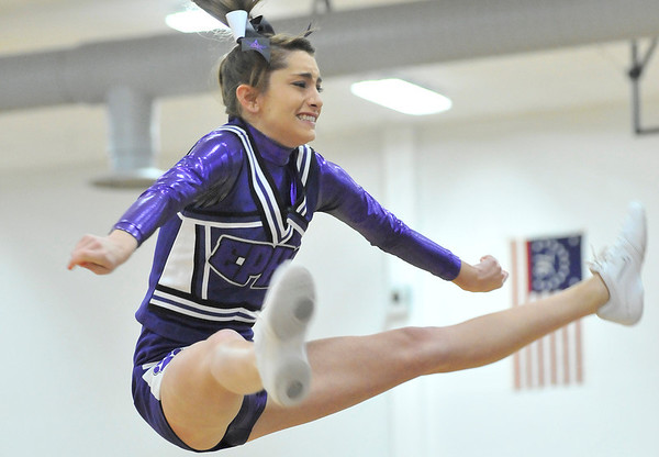 Walt Hester | Trail Gazette<br /> Estes Park Cheerleader Bri Barlow looks a little anxious as she performs at Monday's basketball game. Barlow's usual base cheerleaders those responsible for catching her, were out, though the newer base girls caught Barlow safely.