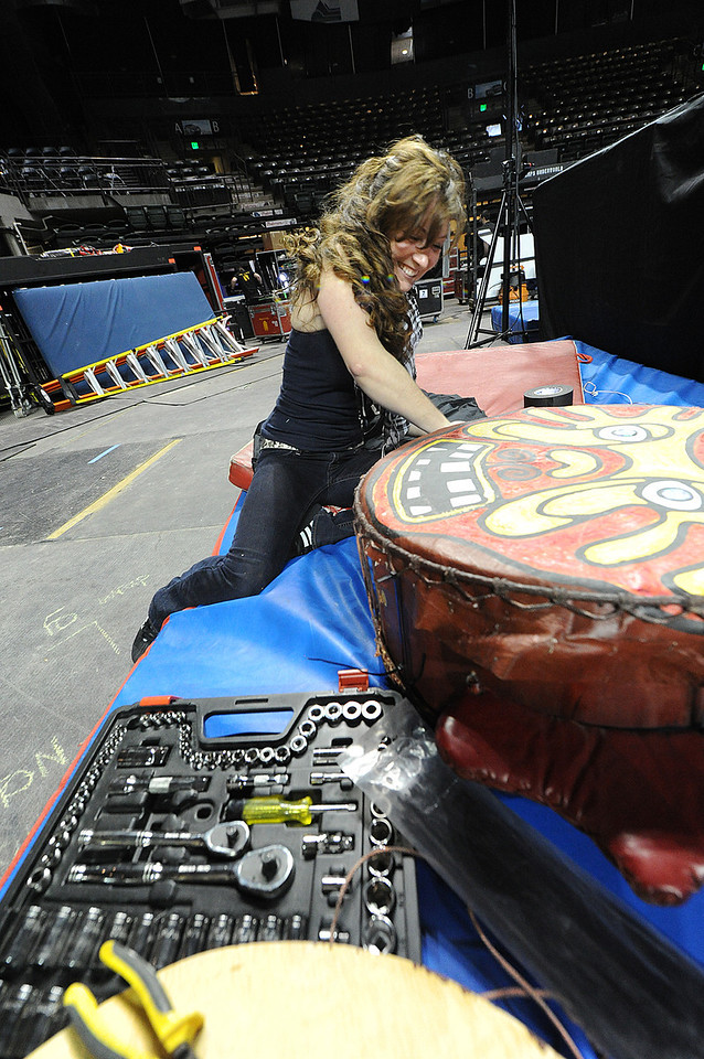 Walt Hester | Trail Gazette<br /> Abgela Everette repairs a prop drum ahead of the Thursday night Cirque du Soleil performance in Loveland. Everette is a Swing Tech Carpenter who has been with Cirque du Soleil, repairin and building props and stages, for a year and a half.