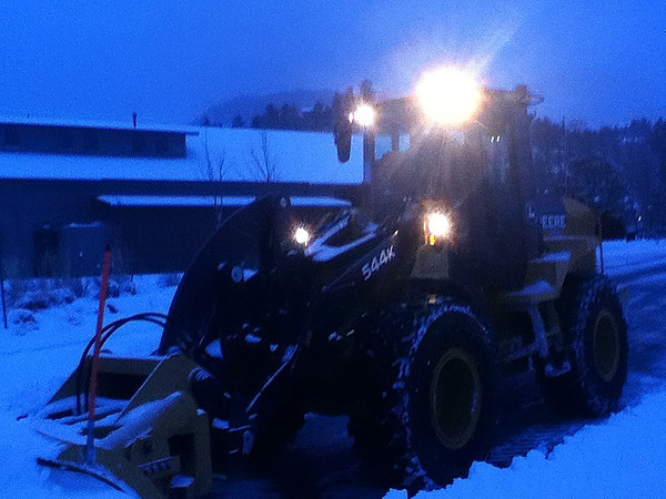 Walt Hester | Trail Gazette<br /> A frontend loader clears snow off of the Estes Park Visitor Center parking lot on Friday. Ten inches had fallen by sun up on Friday morning, with more expected.