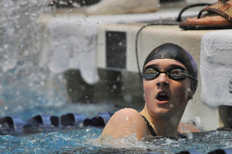 Walt Hester | Trail Gazette<br /> Sophomore Kate Hewson looks up to see her time for the 50-yard freestayle. Hewson was the only Ladycat to make the championship heats.