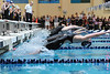 Walt Hester | Trail Gazette<br /> Black-clad swimmers spring backward for the start of the 100-yard backstroke on Saturday. Once rare, hydrophobic speedsuites hav become the norm in high school competitions.
