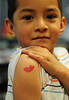 Walt Hester | Trail Gazette<br /> Erik Ortega, 5, shows off a little temperary body art at the Estes Park Elementary School on Wednesday. Even for younger children, a little Valentines Day decoration can be fun.