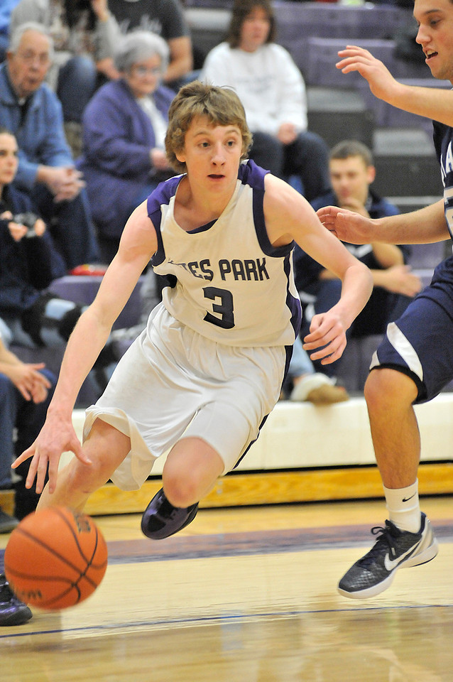 Walt Hester | Trail Gazette<br /> Senior guard Gage Smith drives for the hoop against Platte Valley on Friday. Smith scored 11 points in the losing effort against the Broncos.