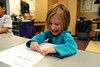 Walt Hester | Trail Gazette<br /> Kindergarten cutie Neve Cooper, 5, colors in a strawberry in art class on Wednesday. The children were lerning their primary colors.