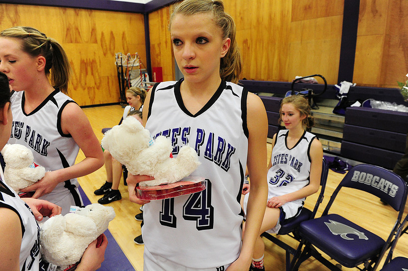 Walt Hester | Trail Gazette<br /> Karin Kingswood and other underclass Ladycats hold gifts for the basketball team's seniors on Tuesday. Seniors gave their parents flowers, as well.