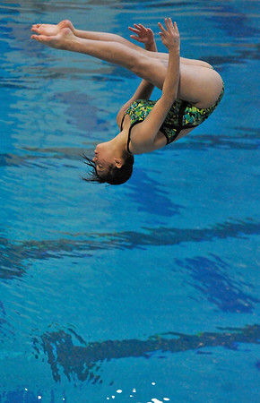 Walt Hester | Trail Gazette<br /> Diver Kimi Tanabe of Manitou Springs releases her pike position and looks for the water during the championship round s of diving on Saturday. While no Ladycats qualified for Saturday's competition this season, three divers are poised to qualify next season for the chance to better the 4A state diving record, held by Estes Park's Liz Pike.