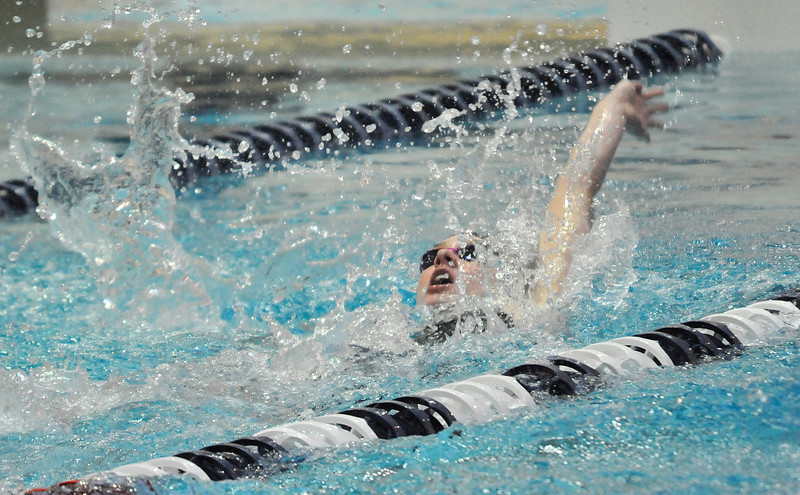 Walt Hester   Trail Gazette<br /> Emma Reins competes in the consolation heat of the 100-yard backstroke on Saturday. Reins' time  was just shy of the championship heat on Friday.