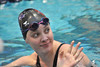 Walt Hester | Trail Gazette<br /> Sophomore Emms Reins waves to family after her 100-yard backstroke. Reins was just short of her sub-minute goal for the year, she has to years to go.