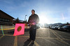 Walt Hester | Trail Gazette<br /> Estes Park Elementary School's Raul Arellano stops traffic in the school's parking lot on Tuesday. WHile chilly, plenty of sunshine greeted students and parent.