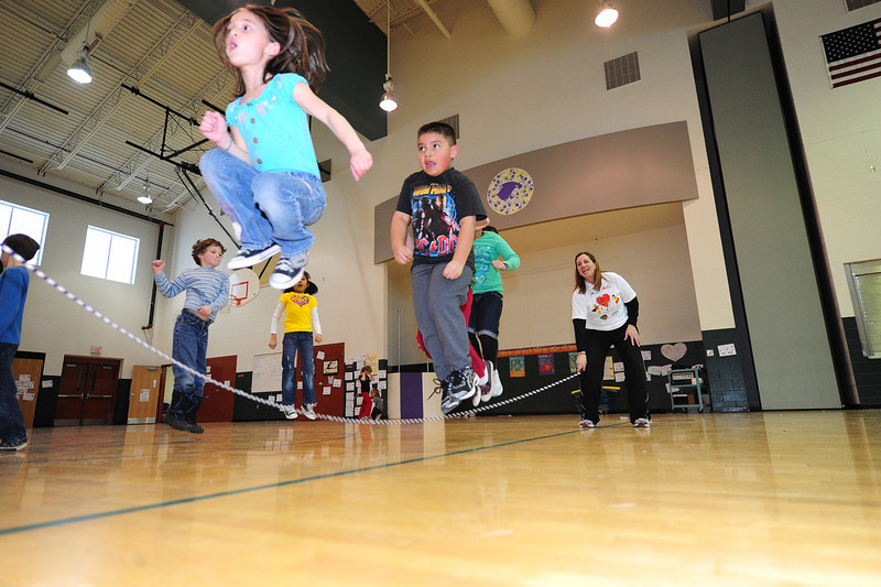 Walt Hester | Trail Gazette<br /> Estes Park Elementary School students take flight in gym class on Wednesdsay. The school was participating in the American Heart Association's Jumprope for Hearts fund raiser.