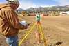 Walt Hester | Trail Gazette<br /> Lonnie Sheldon of VanHorn Engineering surveys what will be the transportation hub parking lot on Wednesday. Crews are staking out the islands and placement of lamp posts.