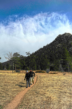 Walt Hester | Trail Gazette<br /> Wendy Stancel and Mike Anslinger hike the Cow Creek Trail in Rocky Mountain National Park on Sunday.