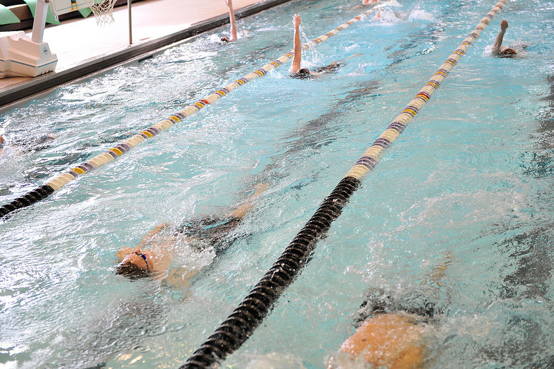 Walt Hester | Trail Gazette<br /> The Bobcats' boys swim teamwarms up with stroke drills at the Aquatic Center on Wednesday. The boys next home meet, which is also their last home meet, will be Thursday, April 14 at 4 p.m..