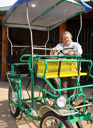 Walt Hester   Trail Gazette<br /> Annie Hanson of the Estes Park Marina hauls out a pedal surrey on Wednesday. The piers are out, the bicycles and surreys are ready, and the boats should be out in May.