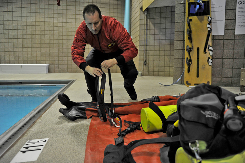 Walt Hester | Trail Gazette<br /> Denmark Litwinchuck prepares for dive rescue training at the Aquatic Center on Tuesday. The Estes Park DIve Rescue Team regularly trains in the diving well at the pool.