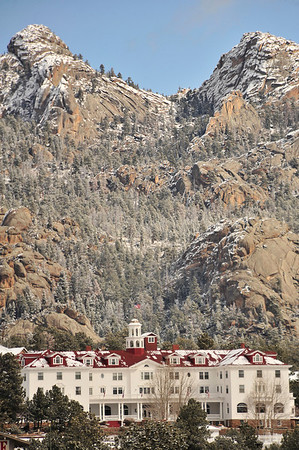 Walt Hester   Trail Gazette<br /> Snow decorates Lumpy Ridge above the Stanley Hotel on Monday. The weather this week is typical of Estes Park this time of year: anything's possible.