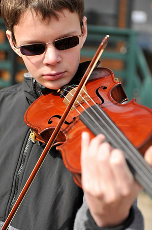 Walt Hester | Trail Gazette<br /> Douglas Klink of Estes Park tunes up his violin on Wednesday. Klink will perform with the instrument next weekend.