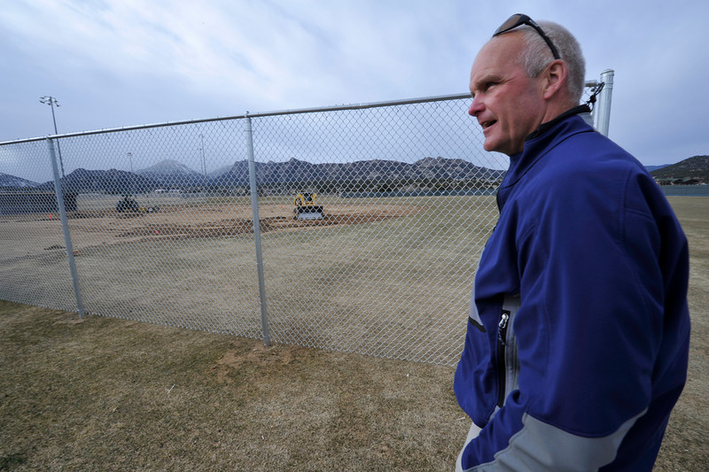 Walt Hester | Trail Gazette<br /> Todd Jirsa checks the progress of field renovation at Stanley Park on Wednesday. The Colorado High School Activities Association demanded upgrades on the field before the Bobcats baseball team was allowed to play this season.