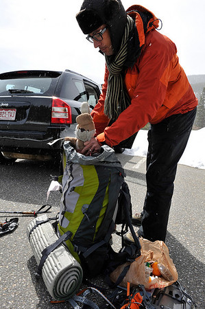 Walt Hester | Trail Gazette<br /> Ale Korb of Munich, Germany, packs his adventurous mascot before heading up th Storm Pass Trail on Wednesday. Korb and climbing partner Stephan Link, will hiked to the Boulder Field Wednesday, and hoped to summit Thursday morning.