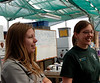 Lindsay Springer, left, park ranger who tends the greenhouse, and volunteer Layla Dunlap, right,  greet the public at the open house at the park's greenhouse on Earth Day.