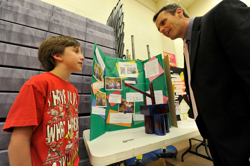 Walt Hester | Trail Gazette<br /> Codi Lasota explains his magnetic science project to Denver's 9News meteorologist Marty Coniglio at the middles school's science fair on Wednesday. Estes Park Middle School students paired up, mostly, to explore questions they themselves had.