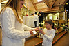Walt Hester | Trail Gazette<br /> Jelsey Flores, 7, takes the Communion cup from Joy Gittings during rehearsal for First Communion on Wednesday. Flores and her classmates will take First Communion for real on Sunday, May 1.