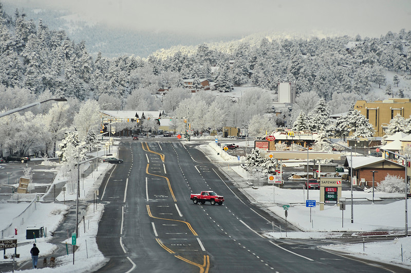 Walt Hester | Trail Gazette<br /> Snow blankets Estes Park on Monday. The temperatures were warm enough that snow quickly melted off the street and sidewalks.