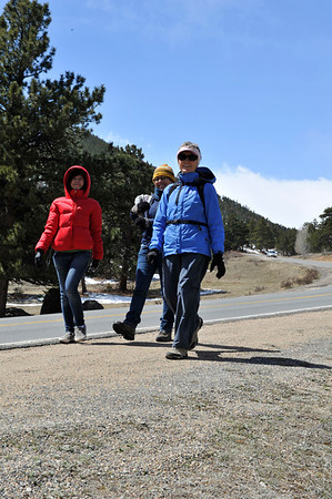 Walt Hester | Trail Gazette<br /> YMCA of the Rockies employees, Linh Vuong of Vietnam, Saby Zaldivar of Peru and Nora Lawler of Denver hike the road out of the national park on Wednesday. While chilly, Wednesday was relatively dry, while rain and snow may return for the weekend.