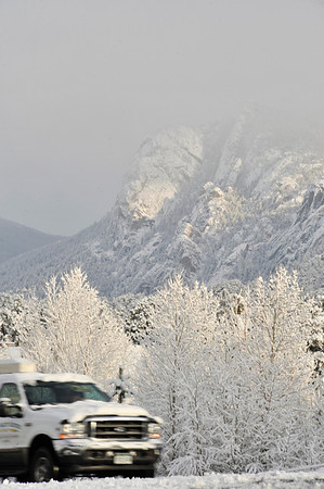 Walt Hester | Trail Gazette<br /> Snow covers trees, peaks and cars in Estes Park on Monday morning. Estes Park my get a break mid-week, before snow returns for the weekend.