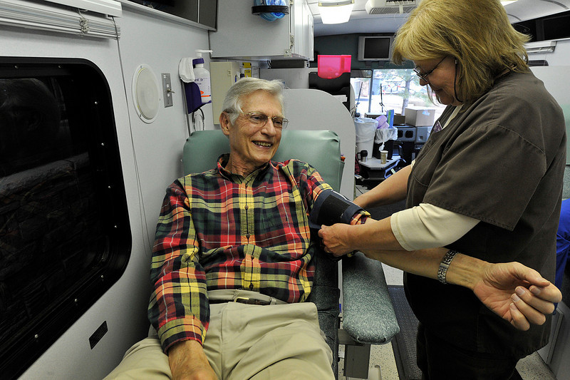 Walt Hester | Trail Gazette<br /> Glen Nieman of Estes Park gets comfortable while Cheryl McKenzie of Poudre Valley Hospital prepares to draw blood in the hospital's blood mobile on Monday. The blood mobile allows the blood drive to draw more efficiently.