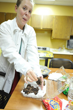 Walt Hester   Trail Gazette<br /> Andrea Dimmitt of Poudre Valley Hospital grabs a home-made brownie between donars on Monday. A hallmark of the blood drives in Estes Park are the home-made goodies the volunteers bake for the post-donation snack bar.