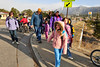 Walt Hester | Trail Gazette<br /> Children and parents cross South St. Vrain Avenue with the help of the Estes Park Police on Friday. The Estes Park Elementary School celebrated Earth Day with their Walk/Ride to School Day, encouraging students and parents to walk or ride bikes and scooters on groups to the school where breakfast was waiting.