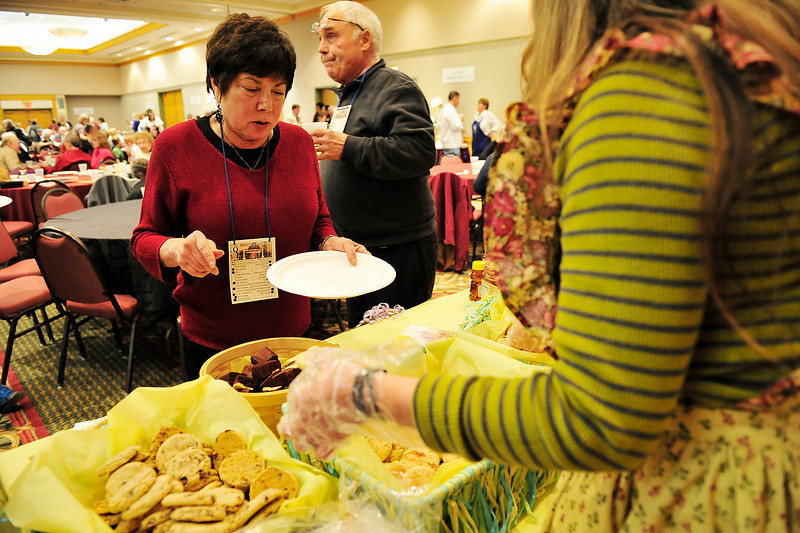 Walt Hester | Trail Gazette<br /> Anne Joseph of Louisville, Ky. picks out cookies from Grandma's Montain Cookies at the annual Taste of Estes at the Estes Park Conference Center on Wednesday. Restaurants of all stripes filled the conference center to offer the best of what they had for the Quota Club fund raiser.