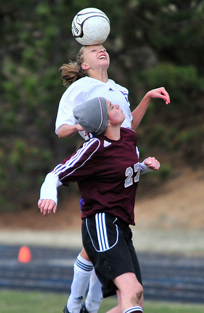 Walt Hester | Trail Gazette<br /> Estes Park's Karin Kingswood gets her head on the ball over Community Christian's Sophia Proano in their match on Thursday. While the Ladycats fought back after being down 2-0 at the half, the Crusaders took the match 3-2.